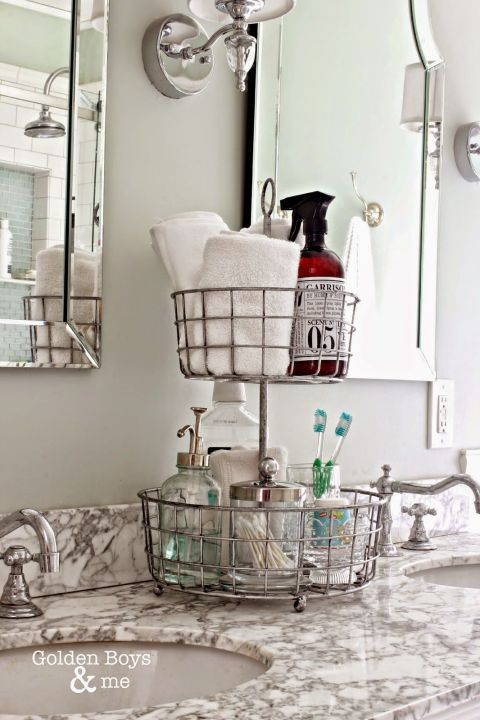 This blogger chose a basket made for kitchen use to create two different bathroom cubbies: One for towels and soap, and the other for products used during nighttime rituals. Click through for more on this and other vanity organization ideas.