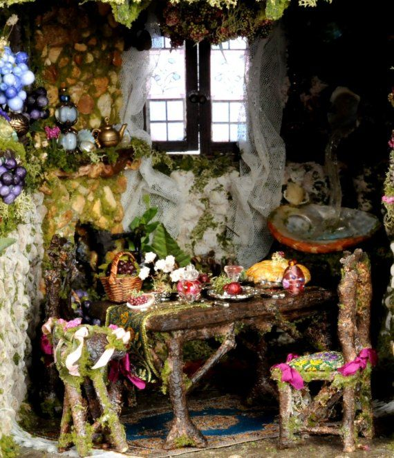 The Cotswold Cottage Fairy Dolls House with twig table and chairs