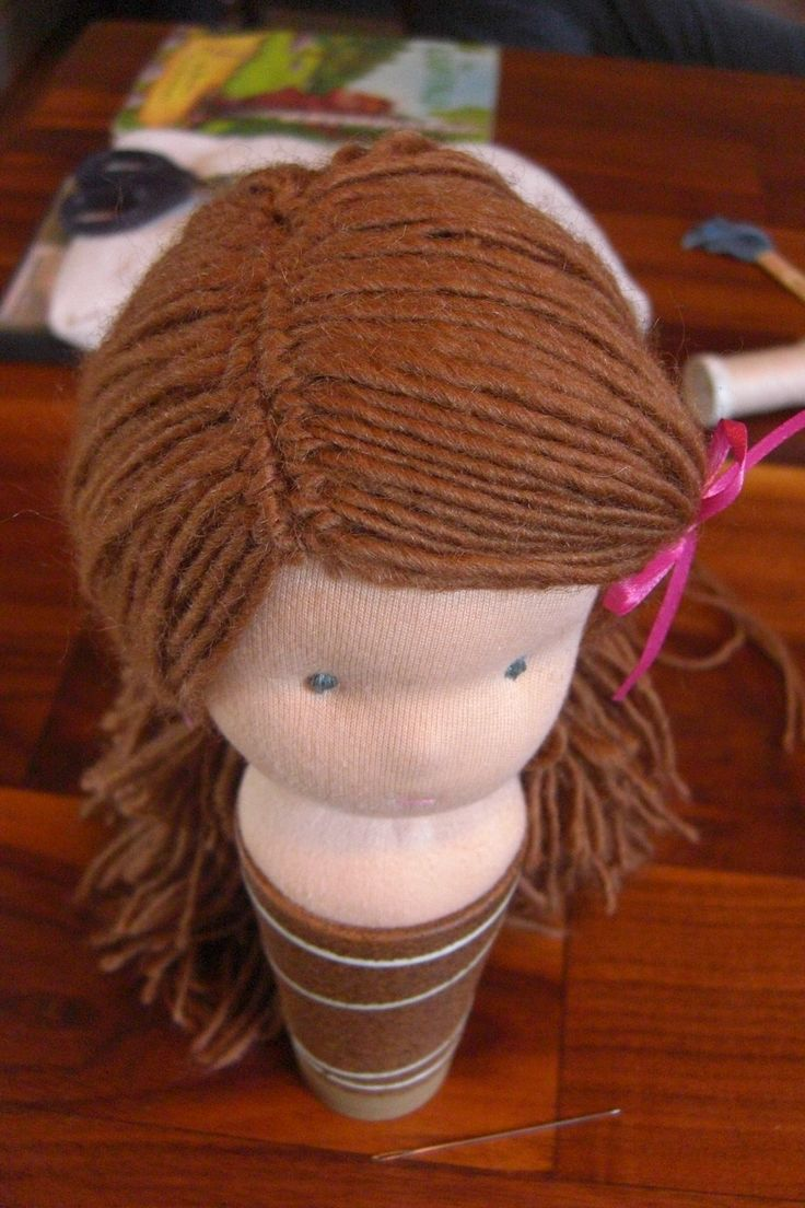 doll hair attached to the head with half-hitch knots