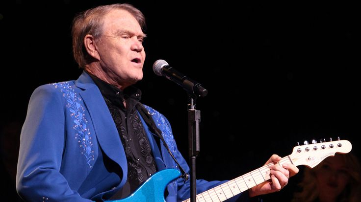 """Country legend Glen Campbell, whose crossover hits """"Gentle on My Mind,"""" """"By the Time I Get to Phoenix"""" and """"Rhinestone Cowboy"""" forged a lasting bridge between country and pop music, died Tuesday. H…"""