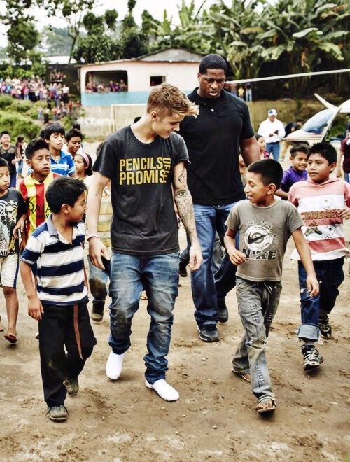 This is the Justin I know. He is walking in his socks because he gave the shoes off his feet to a child who didn't have any.