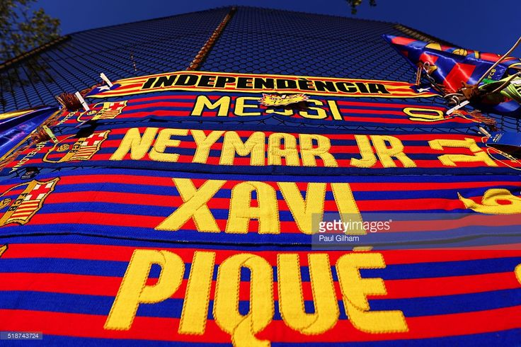 FC Barcelona scarves are displayed for sale outside the stadium before the La Liga match between FC Barcelona and Real Madrid CF at Camp Nou on April 2, 2016 in Barcelona, Spain.