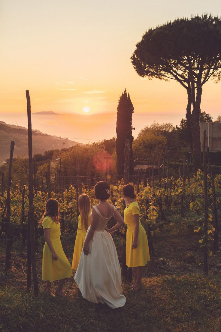 A stylish Italian destination wedding in Sorrento, with a bride wearing a 1960's inspired by by Oleg Cassini.  Photography by Modern Vintage Weddings.