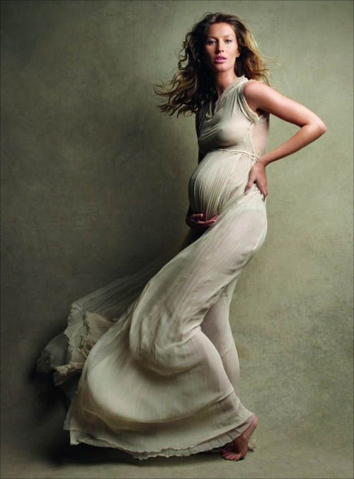 Instead of belly shots, wouldn't it be cool to get maternity shots in an amazing dress?