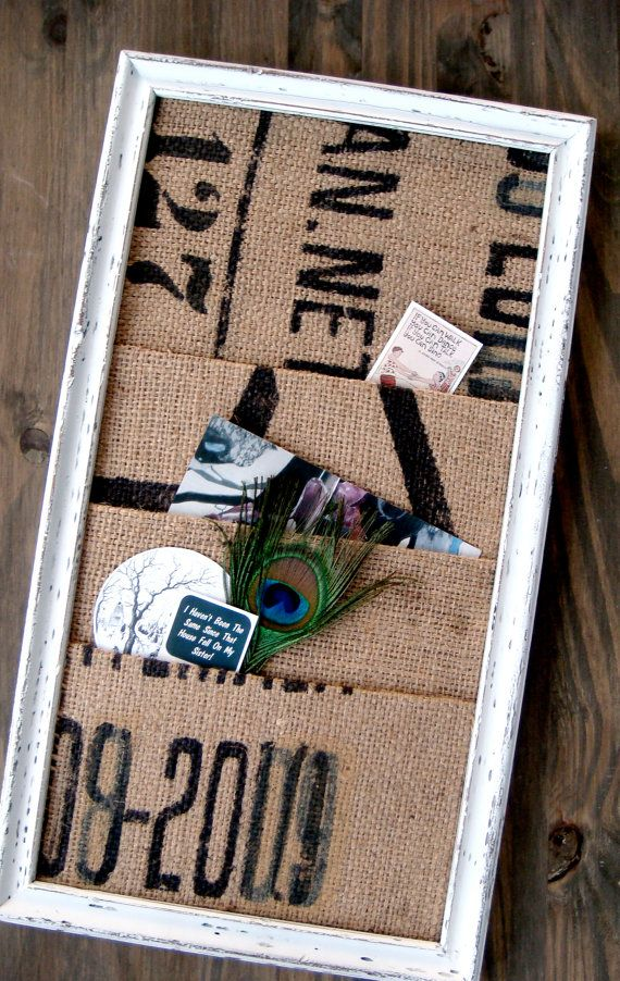 #diy coffee sack/burlap pocket board (find a rustic/unfinished frame a little wider & add some fun knobs along the long side from which to hanging stuff)