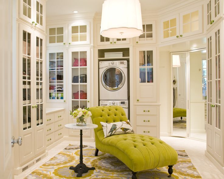 This walk in closet features a washer and dryer, so your clothes never have to travel far. By Austin Bean Design.
