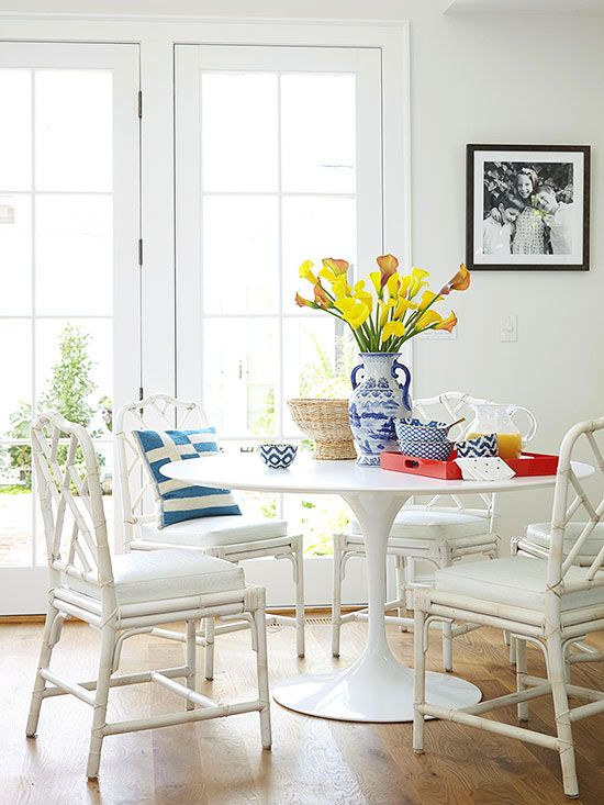 Be mindful of visual weight when you have a small space. Try a sofa that has exposed legs versus a skirt, or a pedestal table for a dining room instead of something with four bulky legs.