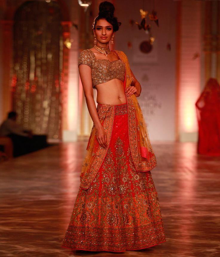 Shaded orange lehenga choli with gold hand embroidery, kundan work and sequin highlights.   Neeta Lulla Online Store