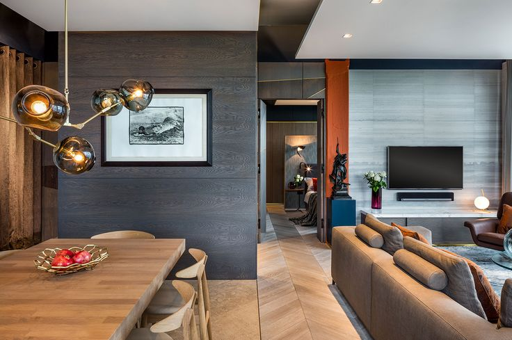 Open plan living and dining space with natural wood flooring and modern brass pendant feature lighting - The Rovers Return Luxury interior designs by Daniel Hopwood and Studio Hopwood. Designs featuring on the Martyn White Designs Blog