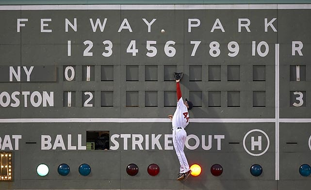 Red Sox outfielder Jason Bay makes a leaping catch during a June 2009 game against the Yankees.  Photographed by: Damian Strohmeyer/SI