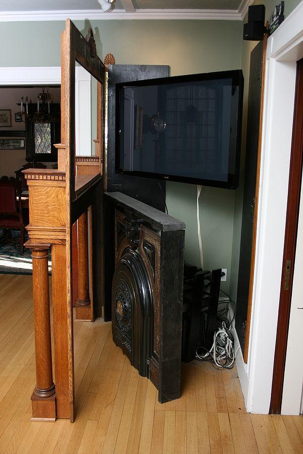 ModVic - The Modern Victorian Steampunk Home    like the corner tv idea with frame that swings out for access to cords