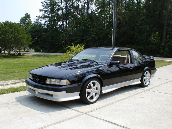 My Wife S 1st Car Black Gray 1990 Chevrolet Cavalier Z24 With A 6 Crammed In The E For 4 It Was Pain To Work On But Fun