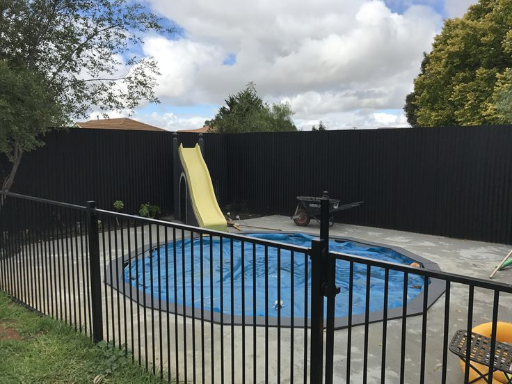 Above ground in ground pool and custom made water slide