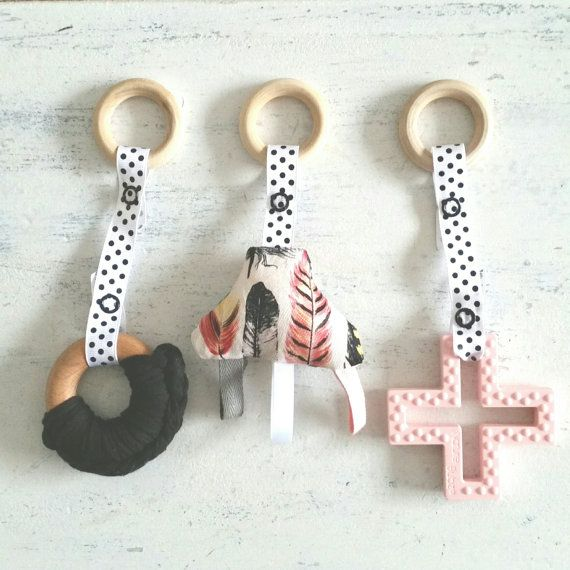 This set is composed of three toys: *swiss cross silicone teether *eco maple…