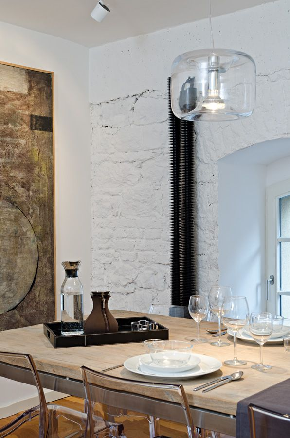 OOOOX | CORNLOFT - dining room with white stone wall