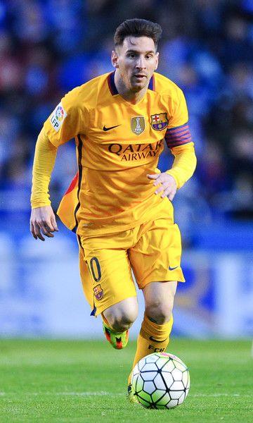 Lionel Messi of FC Barcelona runs with the ball during the La Liga match between RC Deportivo La Coruna and FC Barcelona at Riazor Stadium on April 20, 2016 in La Coruna