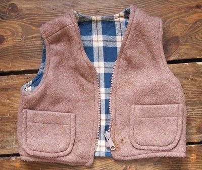 Vintage Waistcoat 12.00 A brilliant fleece waistcoat with cotton check lining from our range of vintage clothes for kids. A great layer.  Age 2 years+  Customise with some of our kids accessories