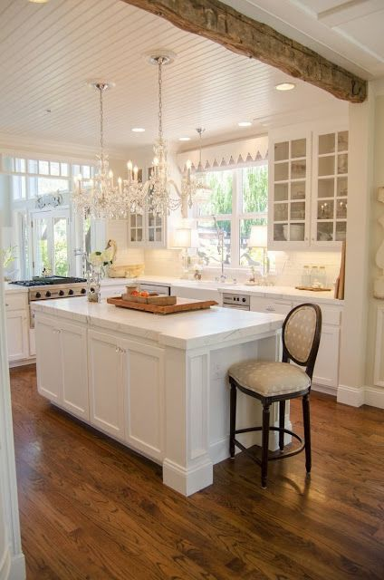 Mod Vintage Life: Kitchen, Glamourized. Gorgeous kitchen! Love the mix of rustic beams with crystal chandeliers.