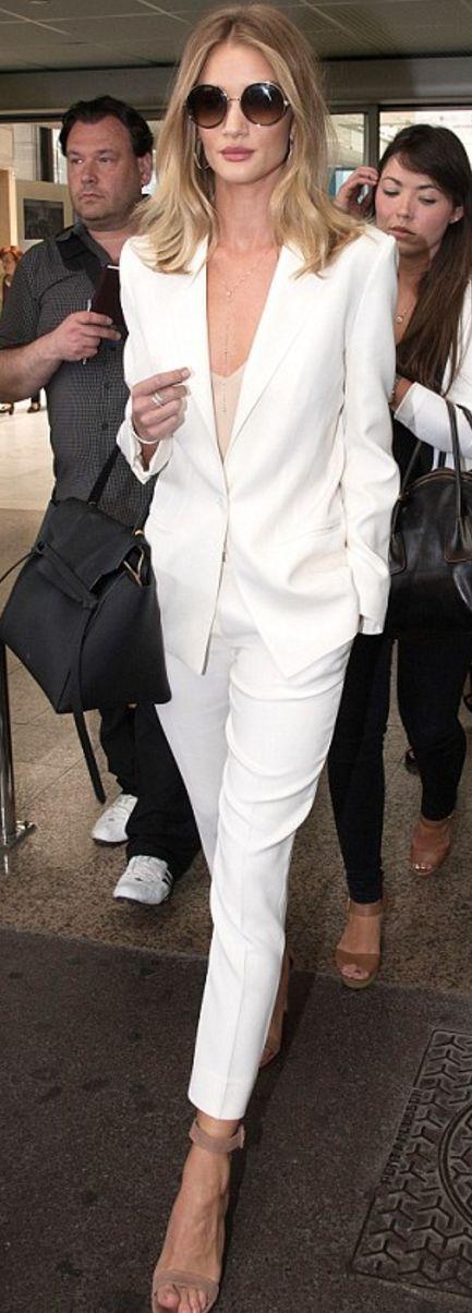 Rosie Huntington-Whiteley: Sunglasses – Jimmy Choo  Bracelet – Anita Ko  Purse – Celine  Jacket and pants – Magda Butrym  Shoes – Gianvito Rossi
