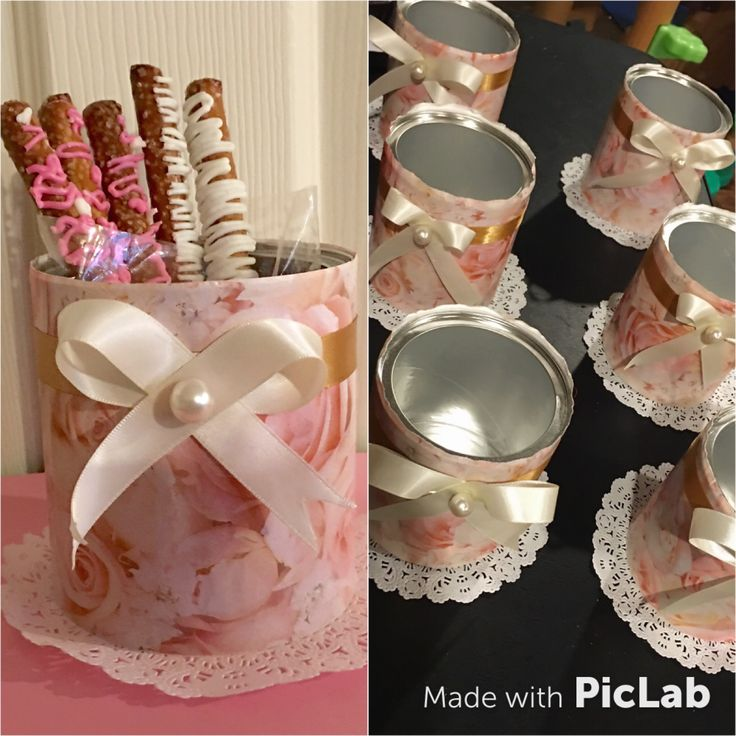 Table center pieces made from a baby formula can! Wrapped can with a decorative wrapping paper and added the bow and pearl to give it a final touch along with the doily in the bottom! Added pretzels inside for guests to enjoy!