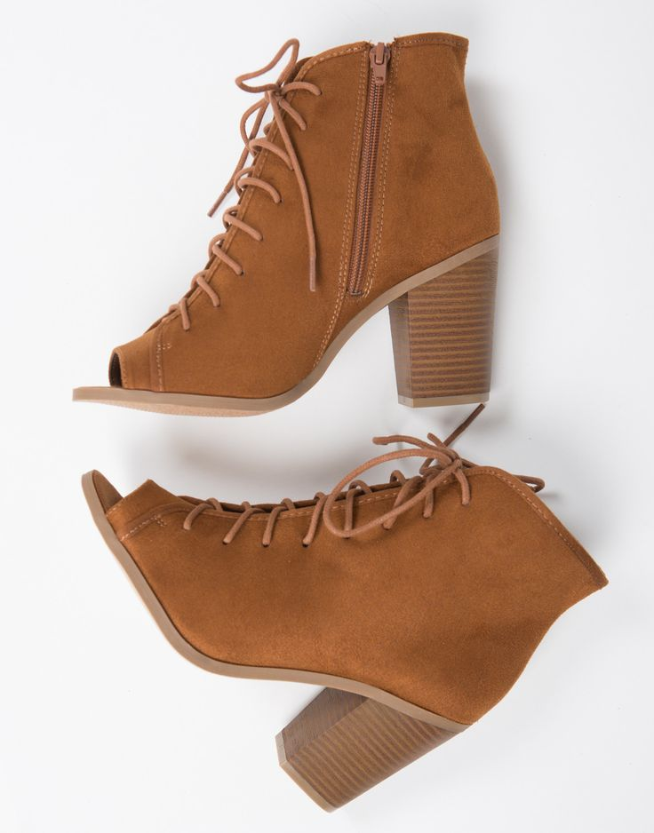 The perfect pair of transition boots! These Peep Toe Lace Up Booties are great for Fall and the Spring. These booties feature a peep toe, lace up details, stacked chunky heel, and a zipper on the insi