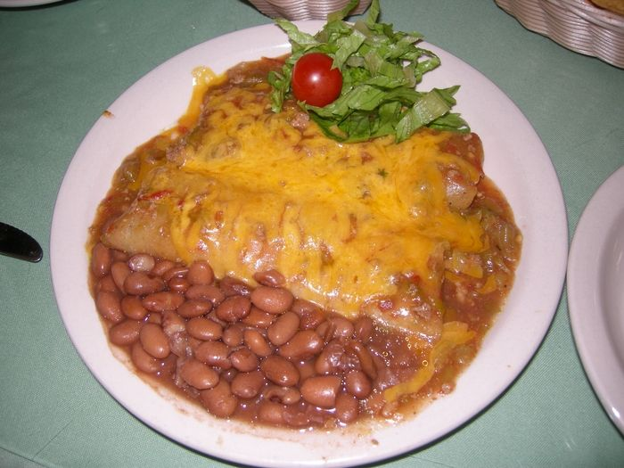 Rancho De Chimayo Restaurante - Chimayo, NM, United States. Chicken Enchiladas with Green Chilies and frijoles. :)