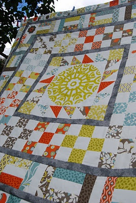 Medallion quilt.  Prints Charming medallion as centre with Moda Arcadia layer cake.