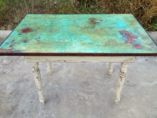 An old farm table top transformed w/ Modern Masters Metal Effects by Peacock Artistic Finishes of Brenham, TX