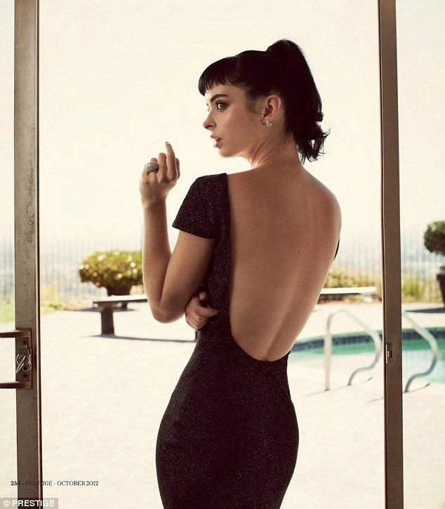 Krysten Ritter reveals her toned tummy as she lounges around poolside in retro bikini   Mail Online