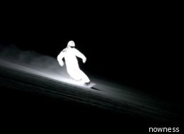 Jacob Sutton's haunting video of pro snowboarder William Hughes cutting through the Alps in an LED-charged snowsuit   the actual video (pin fail)