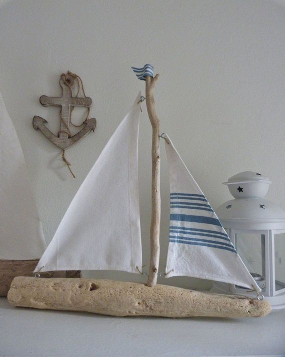this listing is for 1 driftwood sailing boat as in the 2nd photo    handcrafted with weathered rustic driftwood found on Australian beaches. the sails are made from beautiful white cotton fabric with blue and white stripes. the edges of the sails have been sewn and tied with cotton cord to the hull and mast with metal eyelets.    rustic nautical beach house decor    sail away!    35cm x 38cm 14 x 15    ask me about overseas shipping.