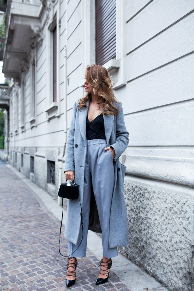 Veronica Ferraro from the fashion blog TheFashionFruit. She is wearing a tailored coat and matching trousers by Italian brand Peserico. The minibag is by Fendi and her heels are by Jimmy Choo. Hairstyle Grant Hairdresser
