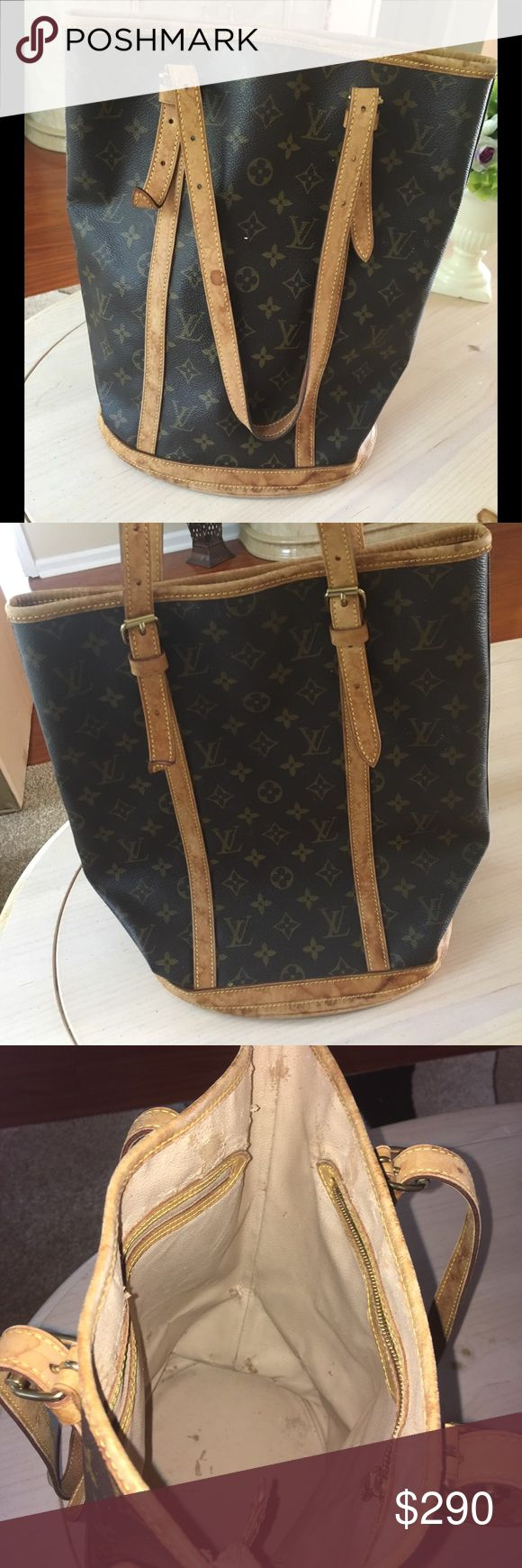 💯% Authentic lv large bucket bag Good condition. Water marks on the leather. Have not tried cleaning it. Normal wear, scratches, rubbing. Inside started to peel and some stickiness. Measures approximately 13.5 x 10.5 x 8 inch. Louis Vuitton Bags Shoulder Bags