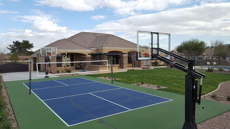 "First Team ""Titan Arena"" adjustable basketball goals and ""Stellar Basic"" volleyball system on backyard court.  www.firstteaminc.com"