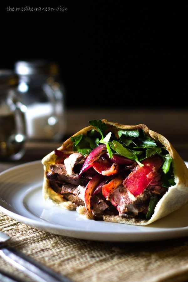 Flank Steak Pita Recipe with Shawarma Spices - Don't work so hard to feed a crowd! Try this awesome pita dinner. Recipe includes photo tutorial and tips for preparing the perfect flank steak. No gas grill needed!  http://www.themediterraneandish.com/flank-steak-pita-recipe-shawarma-spices/