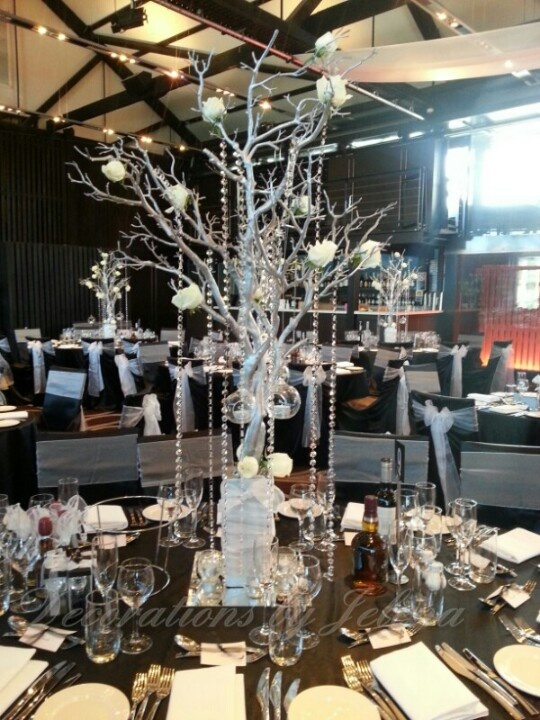 Gorgeous crystal and rose wedding reception centerpiece