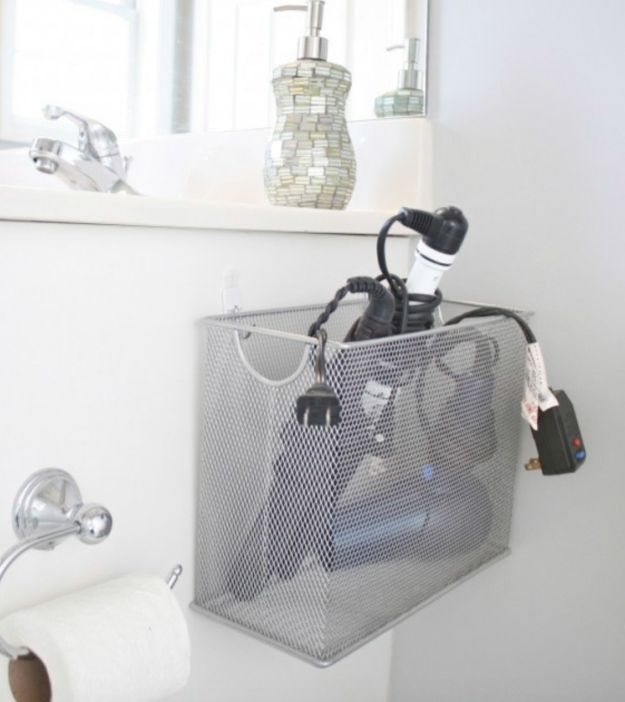 Hang a file box in your bathroom to store your curling iron or blow dryer. | 19 No-Brainer Hacks That'll Make Your Home Really Organized