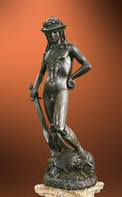 The bronze statue of David (circa 1440s) was sculpted by Donatello and is famous as the first unsupported standing work of bronze cast during the Renaissance, and the first freestanding nude male sculpture made since antiquity. It depicts David with an enigmatic smile, posed with his foot on Goliath's severed head just after defeating the giant.