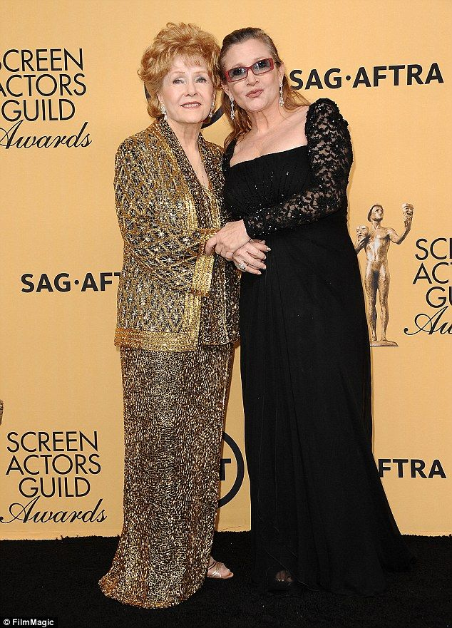 Carrie Fisher's mother Debbie Reynolds (above together in 2015) died on Wednesday - a day after the Star Wars actress