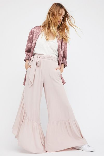 Flattering, stylish and a chic twist on holiday evening wear, there's no denying the appeal of a wide-leg trouser come summer. Look to silky pyjama styles for a nod to the nightwear trend, adding cropped tops or camis for an effortless warm weather look.