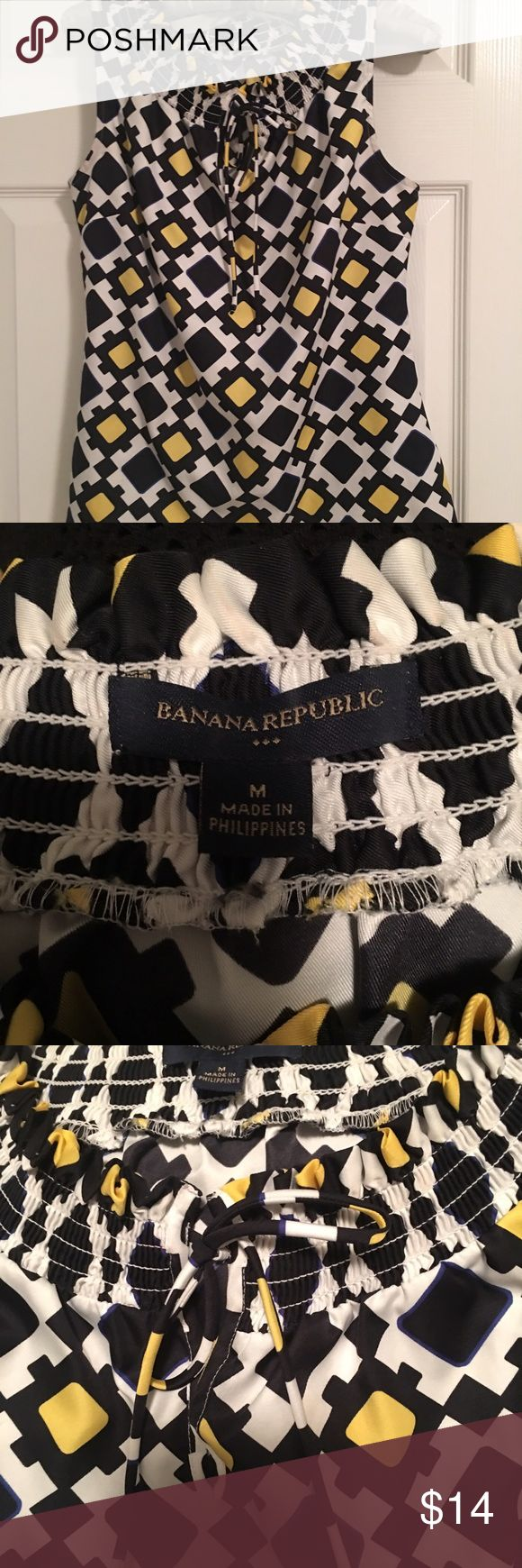 Banana Republic sleeveless top. Size Med. Banana Republic black/yellow print on off white background.  Keyhole front with tie and smocking around neck.  100% polyester...very silky❤️. Excellent condition! Banana Republic Tops Blouses