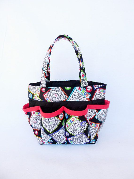 This listing is for the Bingo Card Print Bingo Bag! The other picture I have posted in my store. This large bingo bag is durable, machine washable and has 8 pockets on the outside to hold your bingo daubers. Laying flat the bag is 13 inches wide and 8 1/2 inches tall . the handle is 6