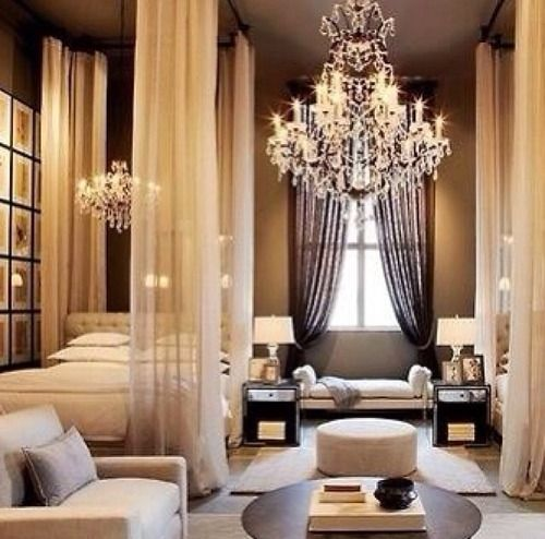 The chandelier, bed curtains, and furniture make this bedroom absolutely beautiful!...x