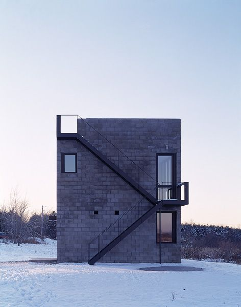 Cube House By Simon Ungers. CHARCOAL CONCRETE BLOCKWORK. EXPOSED BLACK  STEEL STAIRCASE. MINIMAL