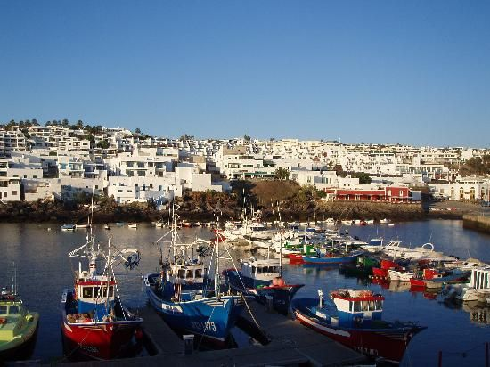 a great place to sit with a cold drink and watch the world go by. old town harbour, puerto del carmen, lanzarote