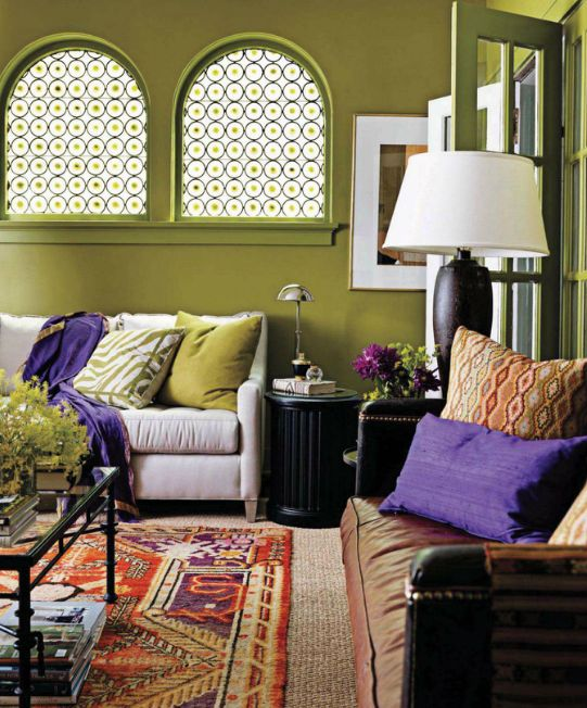 Bohemian Style Living Room Interior Design Ideas With Moss Green Wall Paint And Curved Window Featuring Cozy Seating Purple Pillows Accent Combine