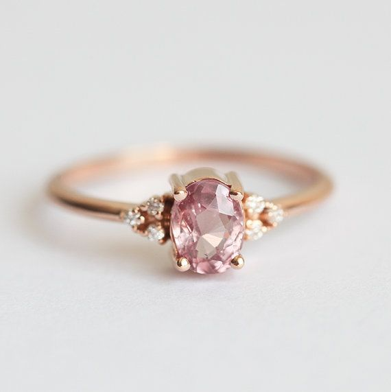 Beautiful simple peach - pink sapphire ring in 14k rose gold. Product details…