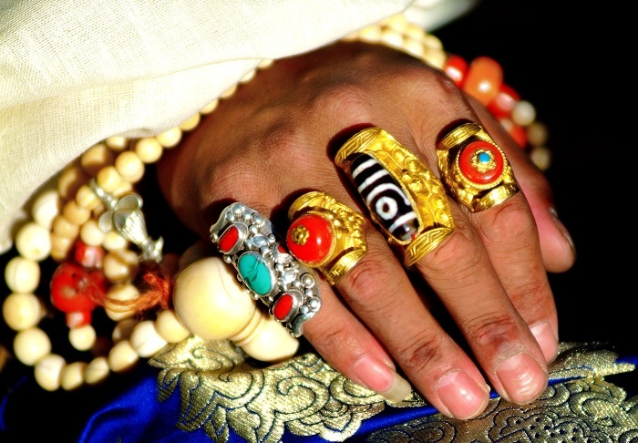 Decorated hands Khampa Tibetan man at the Yushu Horse festival. Some Tibetans, especially in eastern Tibet, invest their wealth into expensive and luxurious jewelry, which they only wear in full at their wedding or at special annual festivals such as the Yushu Horse Festival. At these festivals some of the people (men, women and children) turn up wearing quite spectacular and elaborate ornaments