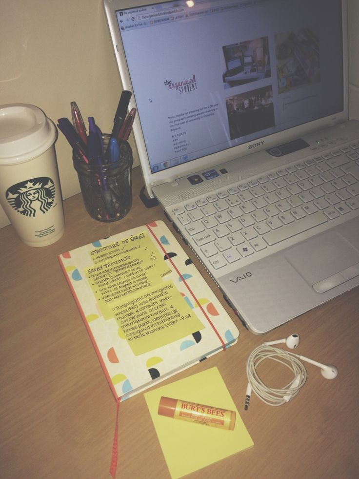 17.11.14, 14:32pm // what's on my desk? • laptop, usually on an essay or tumblr • a mason jar filled the most used items in my pencil case • a refillable cup, usually filled with water • my academic diary, complete with 1000 post-it notes of things I need to remember! • clean post-it's for those mental sparks • earphones - classical music makes me study harder! • burts bees lip balm
