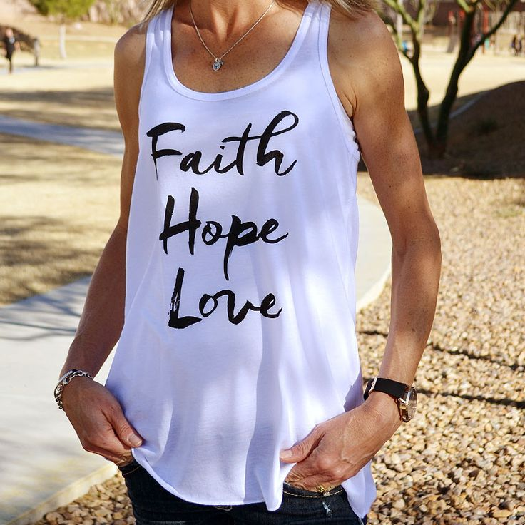 This ultra-soft tri-blend racerback Christian tank features Faith, Hope and Love in black elegant script font. A stylish Christian shirt for women.